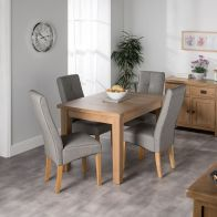 See more information about the Cotswold Oak Dining Table Set With 4 Grey Milan Chairs
