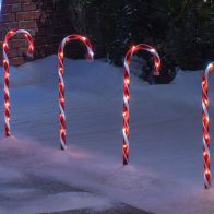 See more information about the 20 LED Red/White Outdoor 25cm Tall Set Of 4 Candy Cane Lights 5m