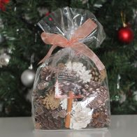See more information about the Festive Exotics Pine & Cinnamon Potpourri In A Bag - Pink Ribbon