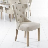 See more information about the Lancelot Winged Back Dining Chair Beige With Button Detailing