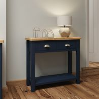 See more information about the Westbridge Light Oak & Blue 2 Drawer Side Table With 1 Shelf